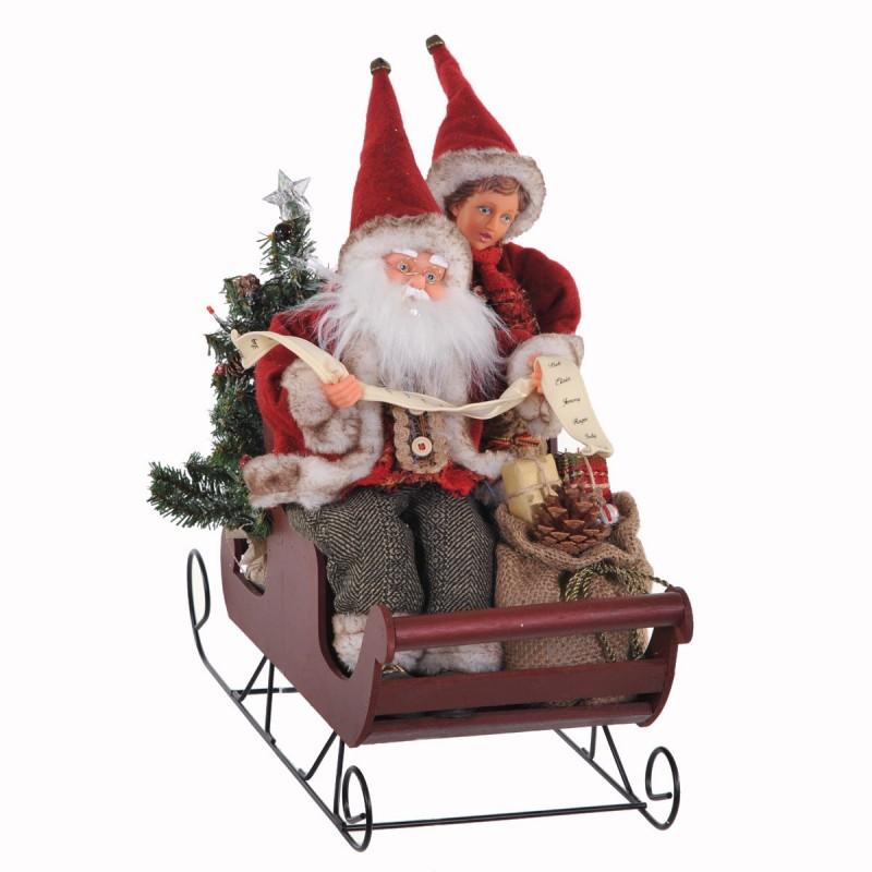 Babbo Natale e bimbo  su slitta in legno con Movimento e Musica colore rosso